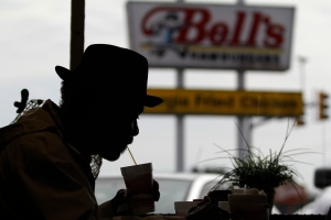 Rebert Price, 62, from Chicago, Illinois is a carpenter who works with trim work, he is eating a meal at Bell's Hamburgers in Toccoa, Georgia, on Saturday, February 28, 2015. Price is sipping a drink at the first booth while eating a meal at Bell's. (Photo/Hannah Kicklighter, hkick94@uga.edu) (Price: 706-599-9969)