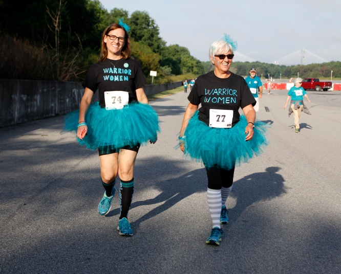 Joie Godfry, 46, manger at Kroger in Woodstock, Georgia, left, walks with her mother, Vicki Granville, 65, a retired preschool teacher from Marietta, Georgia, at the Help the Hoo-Hahs 5K race supporting GYN cancer research. Godfry said her mother helped her throughout her three battles with cervical cancer, and even planned most of her wedding for her in the process.