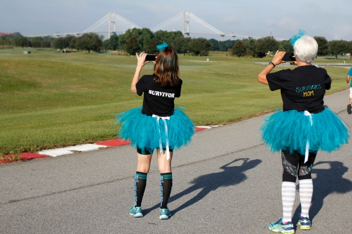 Joie Godfry, 46, manger at Kroger in Woodstock, Georgia, left, pauses to take pictures of the Savannah skyline with her mother, Vicki Granville, 65, a retired preschool teacher from Marietta, Georgia, at the Help the Hoo-Hahs 5K race supporting GYN cancer. Godfry has had cervical cancer three times, and likes this particular organization because it encompasses more than one cancer women can contract.