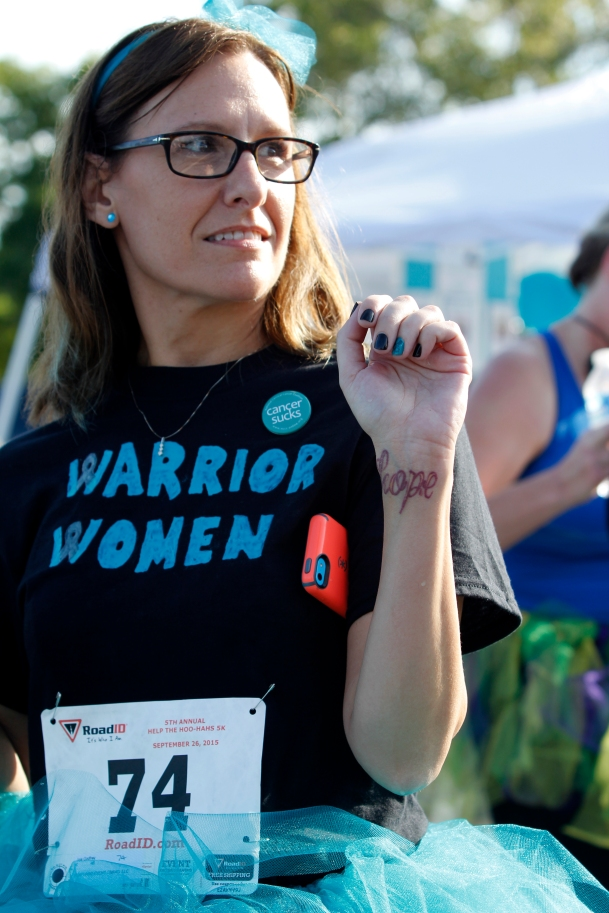 "Joie Godfry, 46, a Kroger manager from Woodstock, Georgia, celebrates her completion of the Help the Hoo-Has 5K in Savannah, Georgia, on September 26, 2015, by flashing her tattoo that reads, ""hope."" Godfry decided to get the tattoo after her cervical cancer returned after six years in remission."