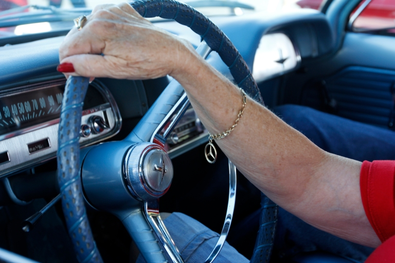 Joan Couch, 75, a retired flight attendent at Delta, from Perry, Georgia, sits in her 1964 Corvair Monza at the Georgia National Fair in Perry, Georgia on October 10, 2015. Couch met her husband at a Mercedes car show. Together they own 10 cars.