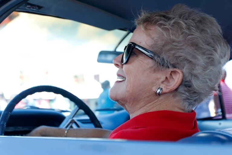 Joan Couch, 75, a retired flight attendent at Delta, from Perry, Georgia, sits in her 1964 Corvair Monza at the Georgia National Fair in Perry, Georgia, on October 10,  2015. Couch enjoys meeting new people and seeing old friends at car shows.