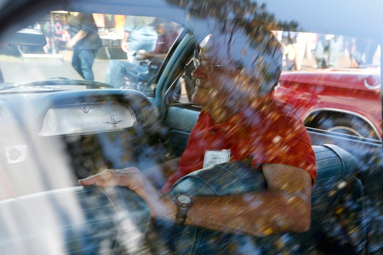 Tommy Couch, 73, a car lot owner from Mississippi, sits in his wife's 1964 Corvair at the Georgia National Fair in Perry, Georgia, on Saturday October 10, 2015. Couch recalls seeing his wife at car shows and thinking that she didn't notice him. He now works on her cars and even helps her garden at home.