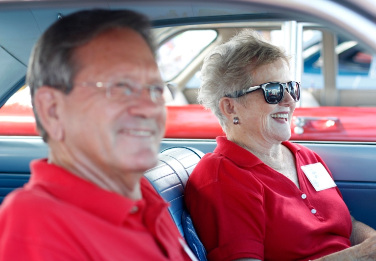 Joan Couch, 75, a retired flight attendent at Delta, from Perry, Georgia, sits in her 1964 Corvair Monza with husband, Tommy Couch, 73, car lot owner from Mississippi, at the Georgia National Fair in Perry, Georgia, on October 10,  2015. The two met at a Mercedes car show a few years ago and hit it off, Tommy began to court Joan soon after.