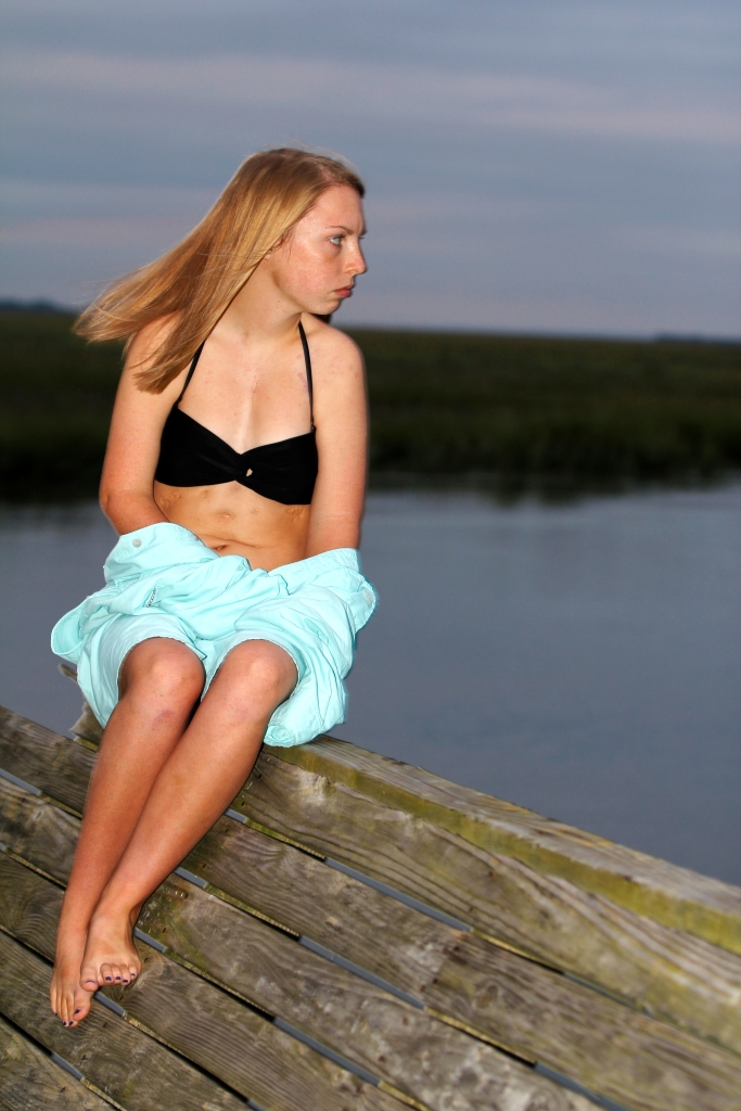 Amanda Rice, 17, sits on the dock at her home on Tybee Island. Amanda hopes to become a camp counselor for kids with heart problems.
